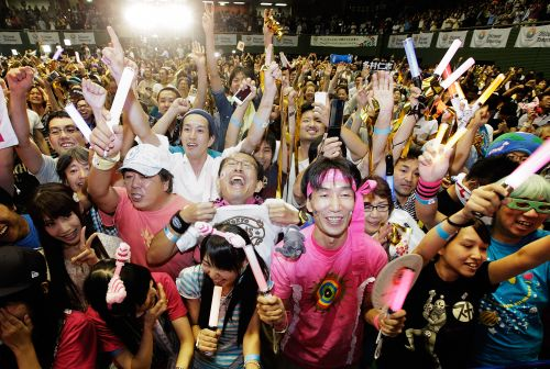Fans celebrate after the announcement of the 2020 Summer Olympic Games host city at Komazawa Olympic Park