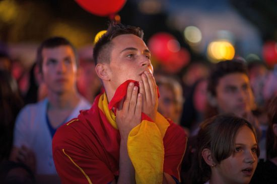 A young man reacts after Madrid was eliminated from the 2020 Olympic Candidacy decision