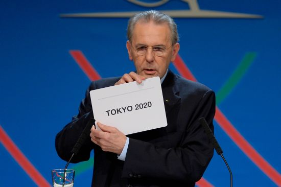 International Olympic Committee (IOC) President Jacques Rogge shows the name of the city of Tokyo elected to host the 2020 Summer Olympics