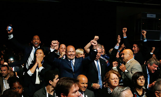 International Federation of Associated Wrestling Styles (FILA) delegation celebrate as   their sport is voted to be included in the 2020 Summer Olympic Games during the 125th IOC   Session - New Sport Announcement in Buenos Aires, Argentina, on Sunday