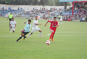 An Army Red player beats Pune FC's 'keeper to score on Monday