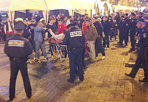 A photo, taken with a mobile phone, shows an injured English soccer fan lying on a stretcher and surrounded by medical personnel