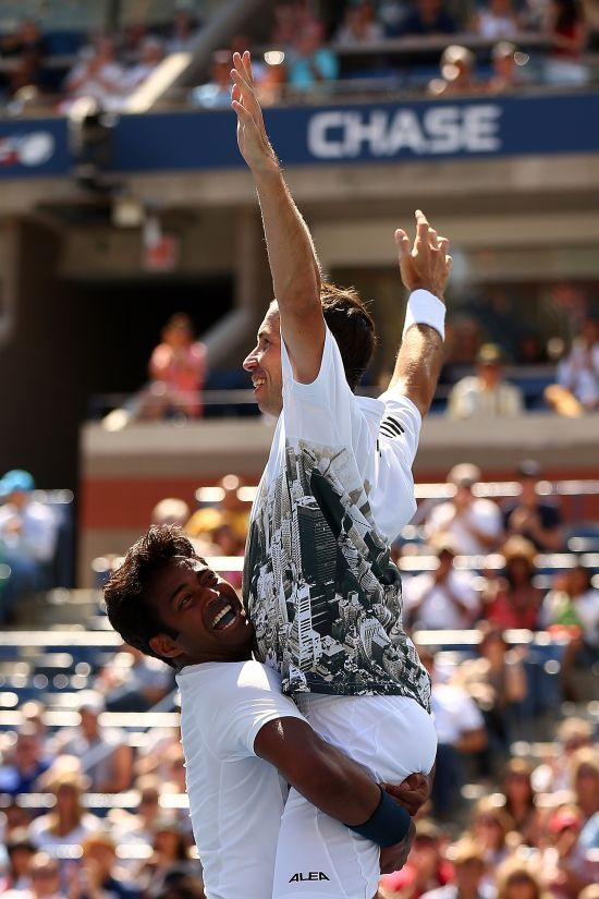 eander Paes (L) of India and Radek Stepanek (R) of the Czech Republic celebrate winning their men's doubles final