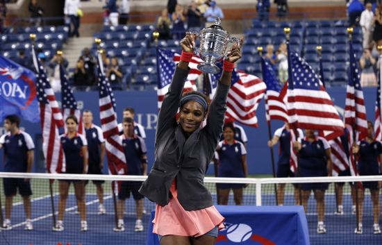 Serena Williams of the U.S. raises her trophy after defeating Victoria Azarenka of Belarus in their women's singles final match at the U.S. Open tennis championships