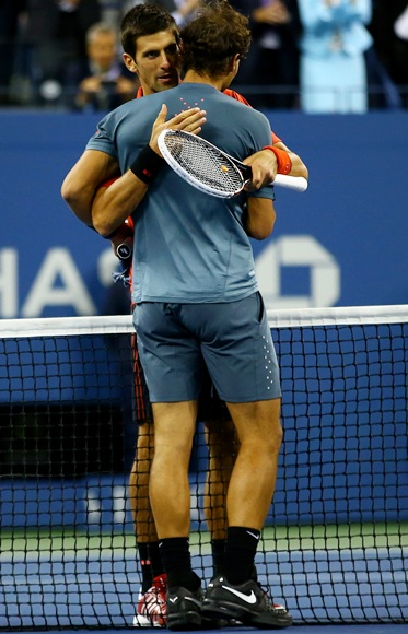 Rafael Nadal of Spain hugs Novak Djokovic of Serbia