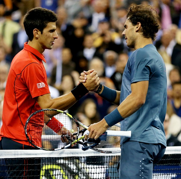 Rafael Nadal of Spain shakes hands at the net with Novak Djokovic of Serbia