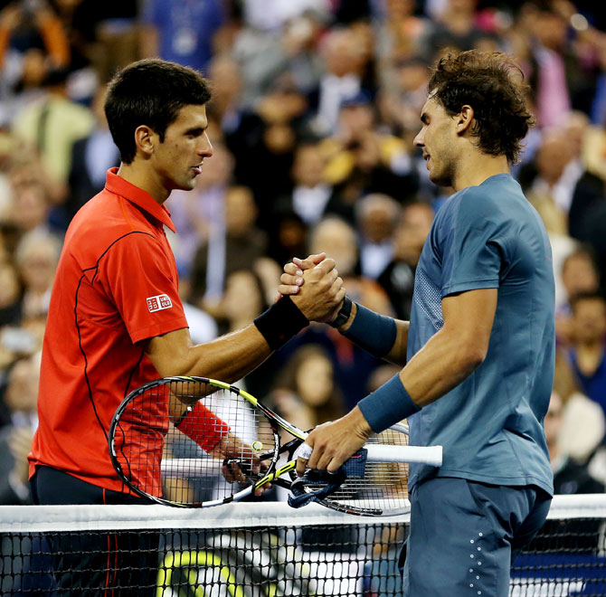 Rafael Nadal of Spain shakes hands at the net with Novak Djokovic of Serbia after their men's singles final at US Open