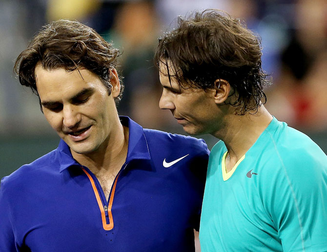 Roger Federer of Switzerland congratulates Rafael Nadal of Spain