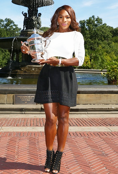 US Open Champion Serena Williams smiles as she poses with the trophy in Central Park
