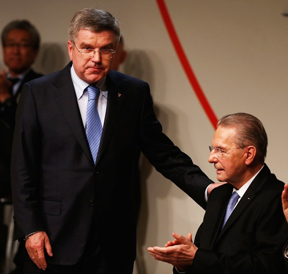 Thomas Bach thanks President of the IOC Jacques Rogge as he is announced as the ninth IOC President