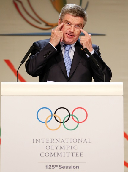Thomas Bach reacts as he is announced as the ninth IOC President