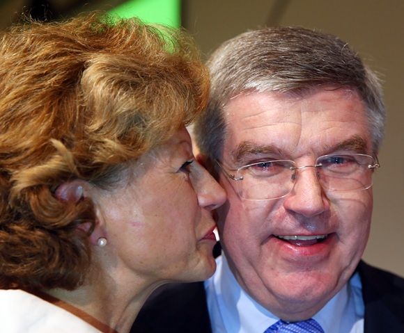Newly announced ninth IOC President Thomas Bach is congratulated by wife Claudia