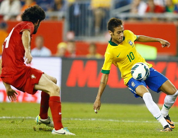Neymar of Brazil traps the ball against Portugal