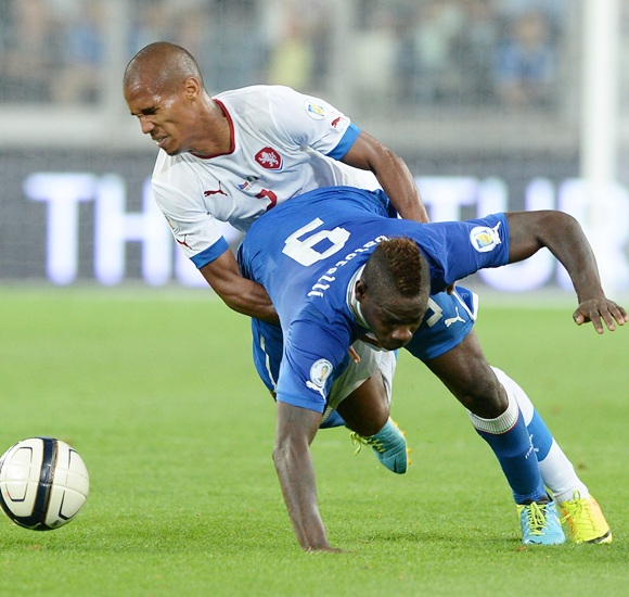 Mario Balotelli of Italy (9) and Theodor Gebreselassie of Czech Republic compete for the ball
