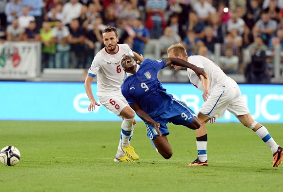 Mario Balotelli of Italy (9) and Daniel Kolar of Czech Republic (right) compete for the ball