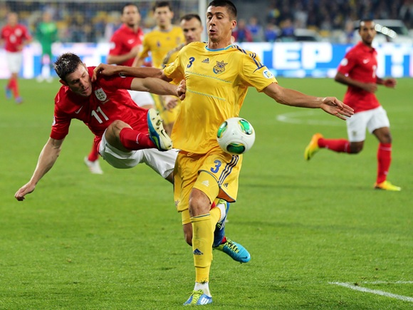 James Milner of England and Yevhen Khacheridi of Ukraine battle for the ball