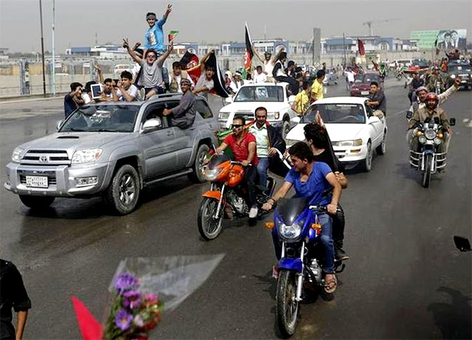 Afghan football fans celebrate winning the South Asian Football Federation championship, in Kabul