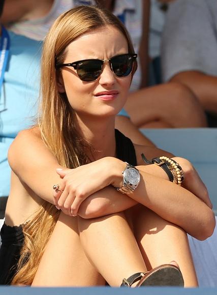 Ester Satorova watches Tomas Berdych of Czech Republic play