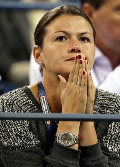 Mikhail Youzhny of Russia's wife Yulia Youzhny reacts