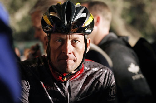 Disgraced cyclist Armstrong returns Sydney Olympic medal