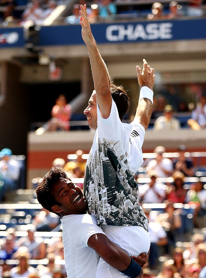 Leander Paes lifts his partner Radek Stepanek after winning the US Open men's doubles title