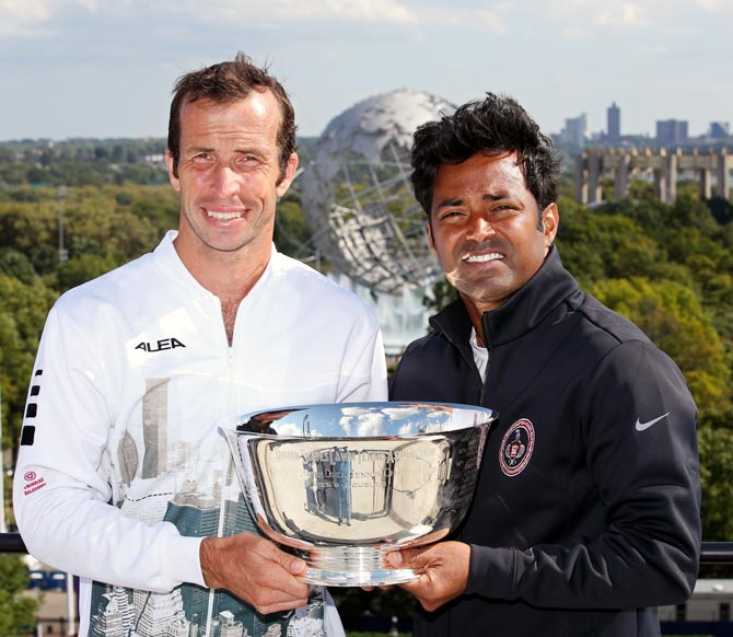 Leander Paes (right) and Radek Stepanek pose with the US Open men's double trophy