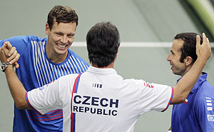 Czech Republic's Radek Stepanek (right) and Tomas Berdych (left) are congratulated by team captain Jaroslav Navratil after defeating Argentina's Horacio Zeballos and Carlos Berlocq during their Davis Cup semi-final doubles match in Prague on Saturday