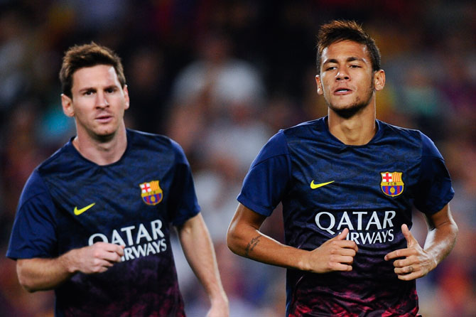 Lionel Messi of FC Barcelona and his team-mate Neymar during the warm up