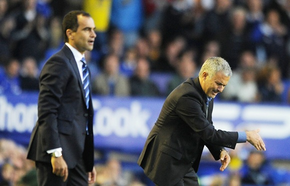 Chelsea Manager Jose Mourinho and Everton Manager Roberto Martinez (left) react