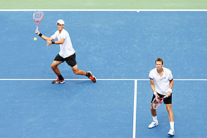Daniel Nestor (right) and Vasek Pospisil of Canada in action