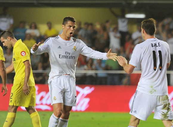 Gareth Bale of Real Madrid celebrates with Cristiano Ronaldo
