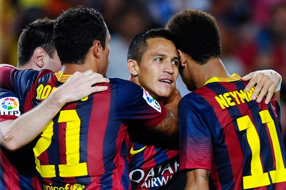 Alexis Sanchez of FC Barcelona (centre) celebrates with his teammates