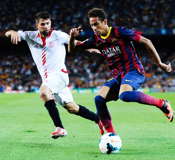 Neymar of FC Barcelona duels for the ball with Jorge Andujar Moreno 'Coke' of Sevilla FC