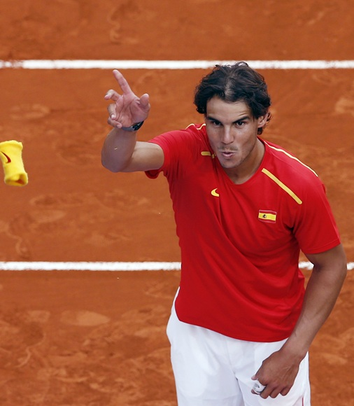 Spain's Rafael Nadal throws his wristband to the public after winning against Ukraine