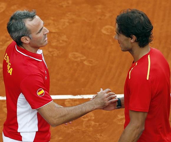 Spain's Rafael Nadal (right) is congratulated by team captain Alex Corretja
