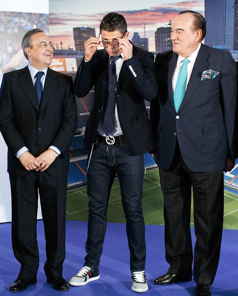 Cristiano Ronaldo (second left) puts on his glasses before posing   alongside Real Madrid president Florentino Perez (left) and Real   Madrid board of management member Fernando Fernandez Tapias (right)