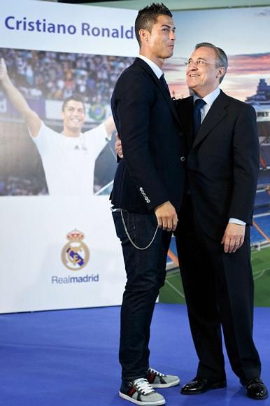 Cristiano Ronaldo (left) stands alongside Real Madrid president Florentino Perez