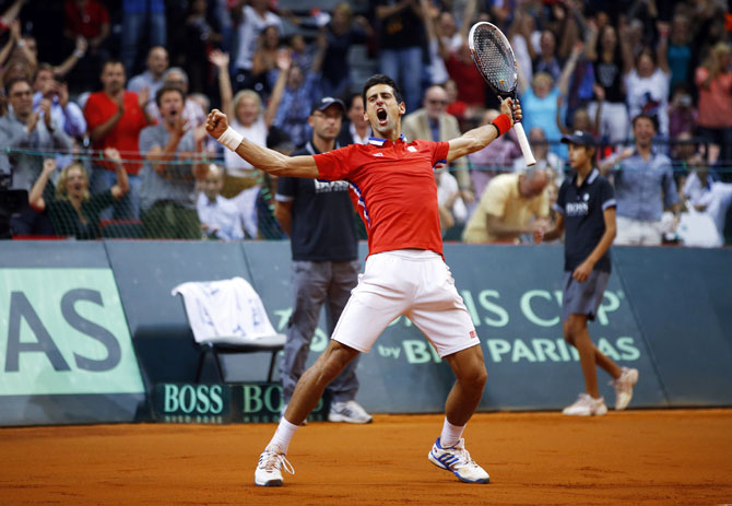 Serbia's Novak Djokovic celebrates his victory over Canada's Milos Raonic