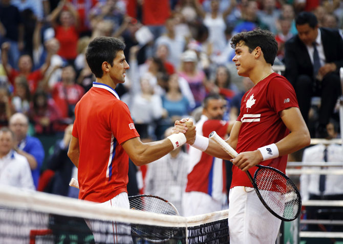 Serbia's Novak Djokovic (left) shakes hands with Canada's Milos Raonic after their Davis Cup semi-final