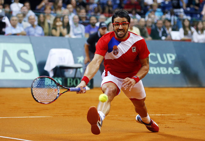 Serbia's Janko Tipsarevic returns the ball to Canada's Vasek Pospisil during their Davis Cup semi-final