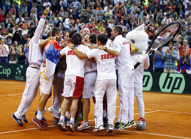 Serbia team players celebrate their victory over Canada after their Davis Cup semi-final