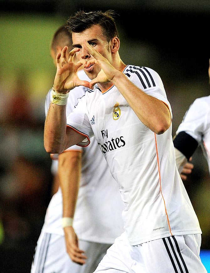 Gareth Bale celebrates after scoring a goal