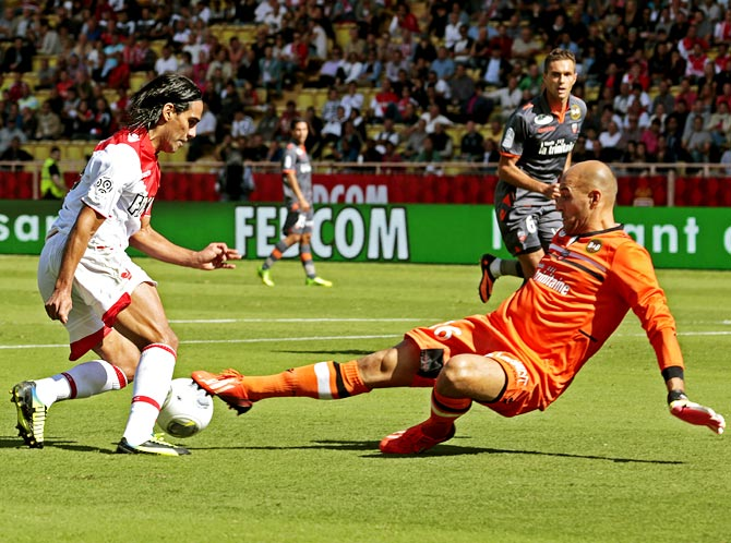 Radamel Falcao tries to get the ball past FC Lorient's goalkeeper Fabien Audard