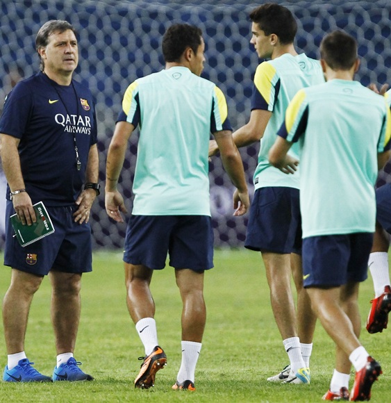 Barcelona's new coach Gerardo Martino (left) gestures to his players