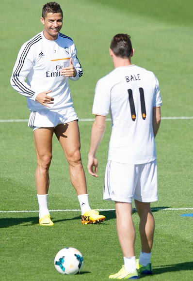 Cristiano Ronaldo chats with Real's new signing Gareth Bale