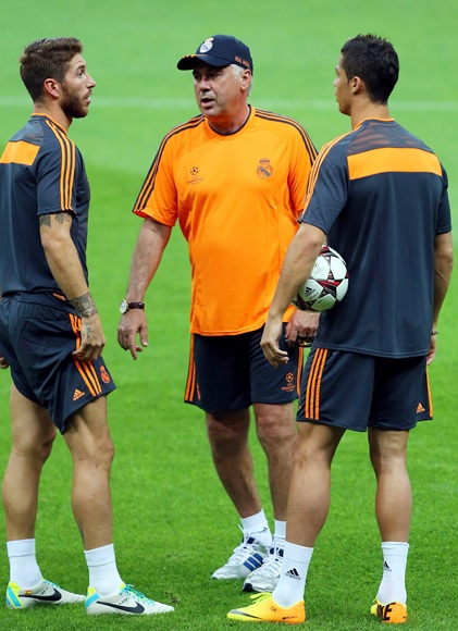Real Madrid's coach Carlo Ancelotti, Sergio Ramos and Christiano Ronaldo attend a training session