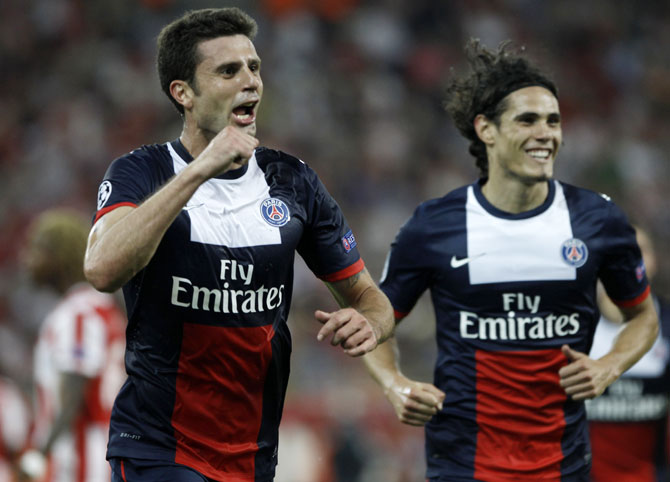 Paris St Germain's Thiago Motta (left) celebrates after scoring against Olympiakos during their Group C match