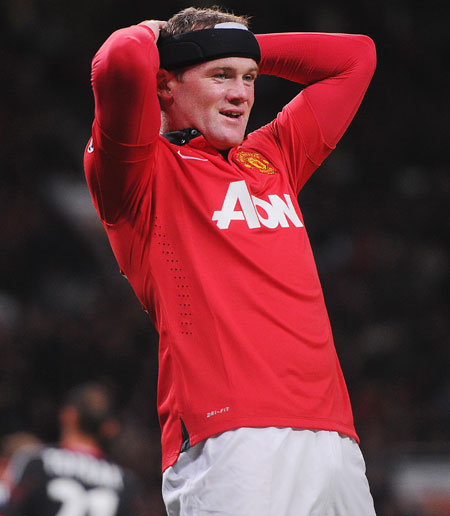 Wayne Rooney of Manchester United reacts during the UEFA Champions League Group A match against Bayer Leverkusen at Old Trafford