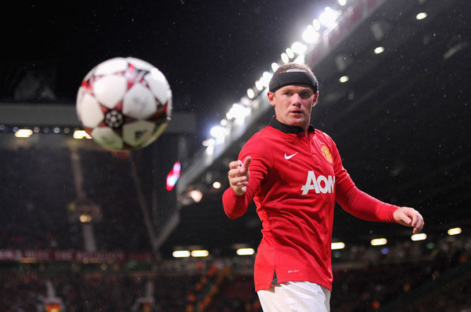Wayne Rooney of Manchester United retrieves the ball