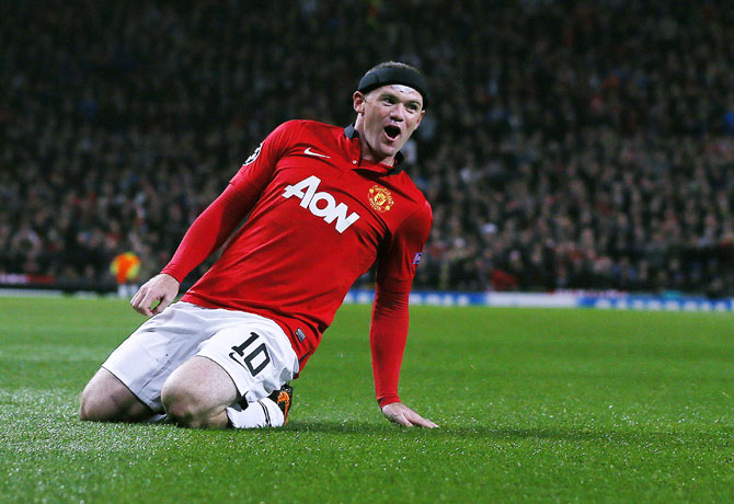 Manchester United's Wayne Rooney celebrates scoring against Bayer Leverkusen